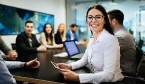 Young woman smiling in business meeting