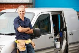 Repair man standing near van