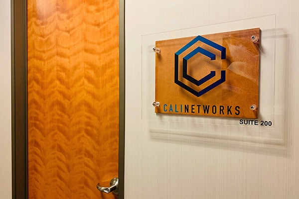 CaliNetworks front door with sign