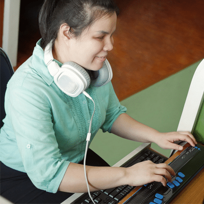 A blind girl using a PC with assistive technology